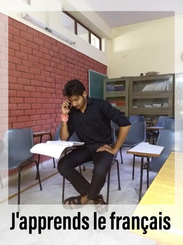 Hari learning french language at school