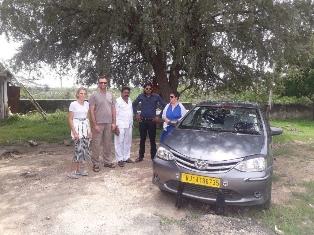 Hari and Rajendra with tourists - Toyota Etios car
